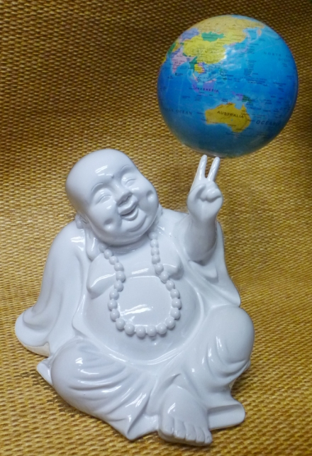 Happy Buddha holding up the world