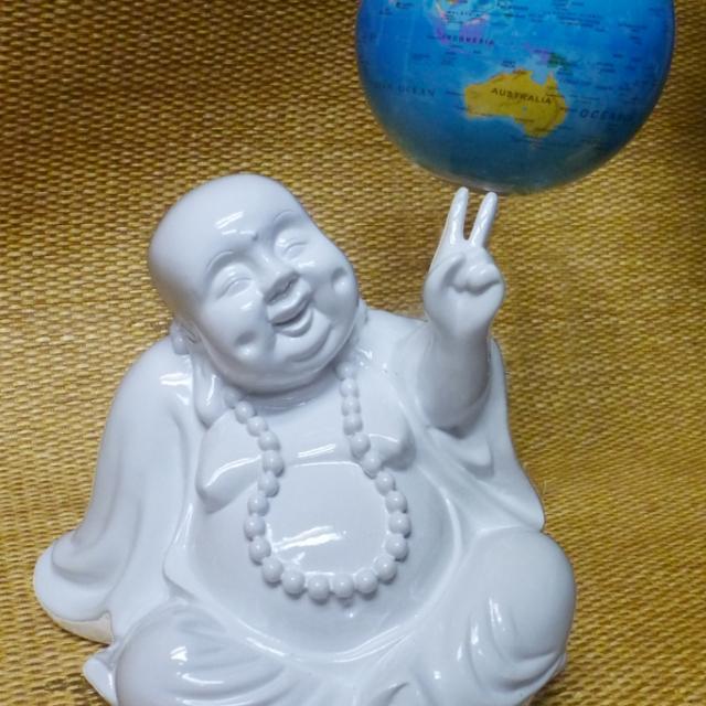 Happy Buddha holding up the world